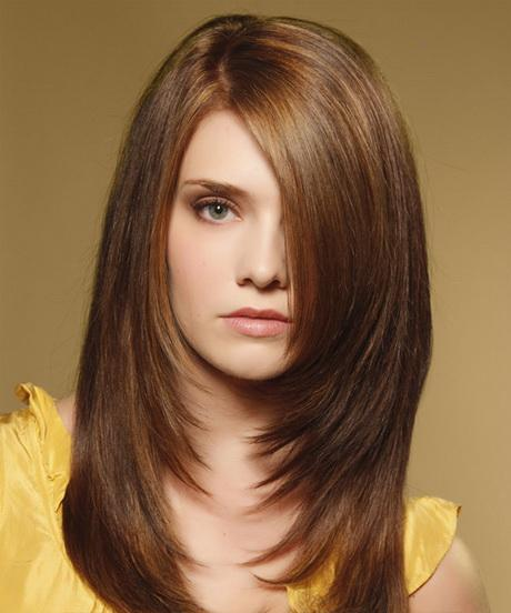 Long layered haircuts with side swept bangs